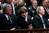 Former Florida Gov. Jeb Bush, Laura Bush and former President George W. Bush listen during a State Funeral for former President George H.W. Bush at the Washington National Cathedral, Wednesday, Dec. 5, 2018, in Washington. <br /> Credit: Alex Brandon / Pool via CNP
