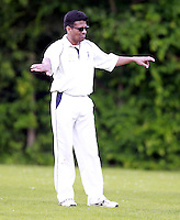 Harrow Town captain Kamlesh Desai directs his field during the ECB Middlesex Division Three game between Highgate and Harrow Town at Park Road, Crouch End on Saturday May 24, 2014
