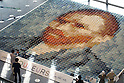 May 13, 2010 - Tokyo, Japan - People watch a reproduction of a Vincent van Gogh self-portrait made of 2,070 polo shirts in 24 different colors, at Marunouchi Building, Tokyo, Japan, on May 13, 2010.The mosaic was created by Tokyo-based apparel maker Onward Kashiyama Co. as part of its campaign to incorporate colors of paintings into clothing designs.
