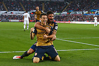 Laurent Koscielny of Arsenal celebrates scoring his goal to make the score 0-2 with Olivier Giroud during the Barclays Premier League match between Swansea City and Arsenal played at The Liberty Stadium, Swansea on October 31st 2015