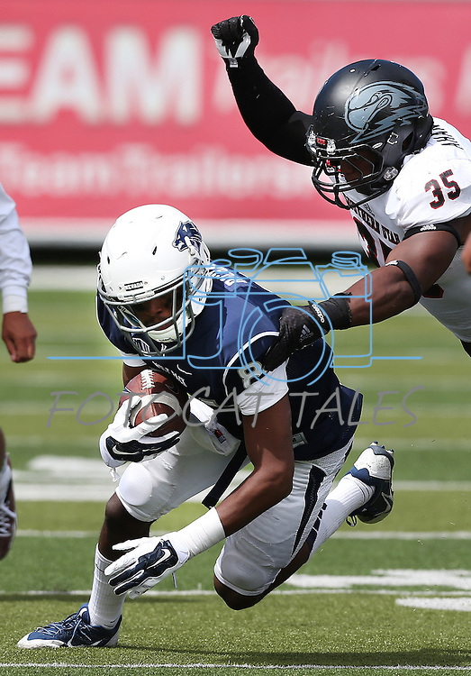 Nevada's Jerico Richardson (84) runs against Southern Utah's Chinedu Ahanonu (35) during the second half of an NCAA college football game on Saturday, Aug. 30, 2014 in Reno, Nev. Nevada defeated Southern Utah 28-19. (AP Photo/Cathleen Allison)