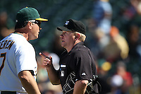 OAKLAND, CA - SEPTEMBER 4:  Home plate umpire Mike Muchlinski argues with Oakland Athletics manager Bob Geren during the game against the Los Angeles Angels of Anaheim at the Oakland-Alameda County Coliseum on September 4, 2010 in Oakland, California. Photo by Brad Mangin