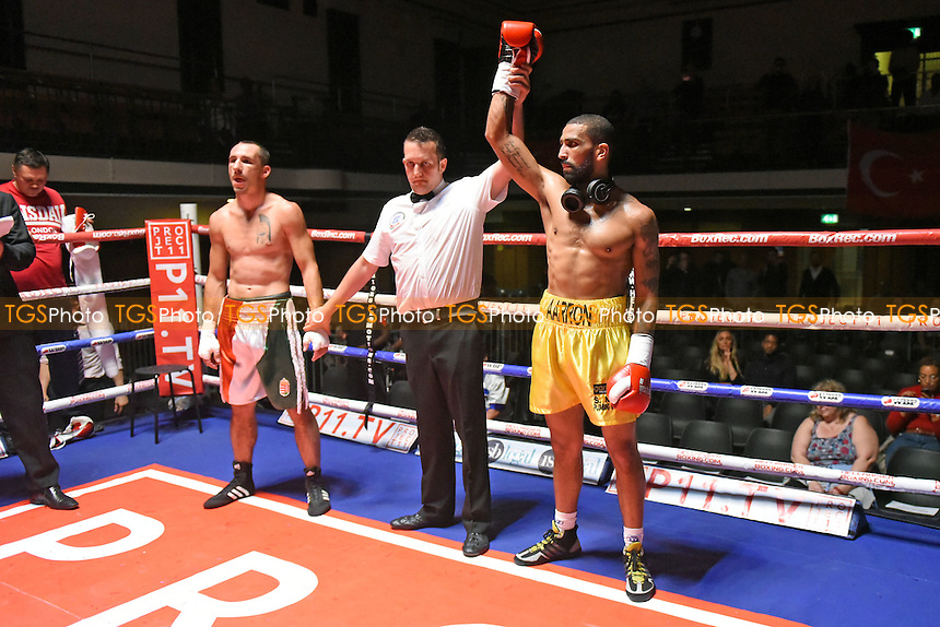 Aaron Morgan (yellow shorts) defeats Kristztian Santa during a Boxing Show at York Hall on 4th June 2016