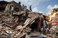 Soldiers from Nepali Army removing the rubble at the Shoyembho temple, just outside Kathmandu, Nepal
