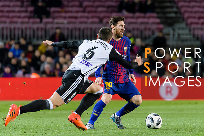 Lionel Messi of FC Barcelona (R) in action against Nemanja Maksimovic of Valencia CF (L) during the Copa Del Rey 2017-18 match between FC Barcelona and Valencia CF at Camp Nou Stadium on 01 February 2018 in Barcelona, Spain. Photo by Vicens Gimenez / Power Sport Images