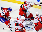 31 March 2010: Carolina Hurricanes' right wing forward Tom Kostopoulos (29) skates into Montreal Canadiens goaltender Carey Price who makes a first period save at the Bell Centre in Montreal, Quebec, Canada. The Hurricanes defeated the Canadiens 2-1 in their last meeting of the regular season. Mandatory Credit: Ed Wolfstein Photo