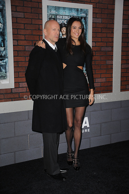 WWW.ACEPIXS.COM . . . . . ....December 17 2009, New York City....Actor Bruce Willis and Emma Heming arriving at the New York premiere of 'Sherlock Holmes' at the Alice Tully Hall, Lincoln Center on December 17, 2009 in New York City.....Please byline: KRISTIN CALLAHAN - ACEPIXS.COM.. . . . . . ..Ace Pictures, Inc:  ..(212) 243-8787 or (646) 679 0430..e-mail: picturedesk@acepixs.com..web: http://www.acepixs.com