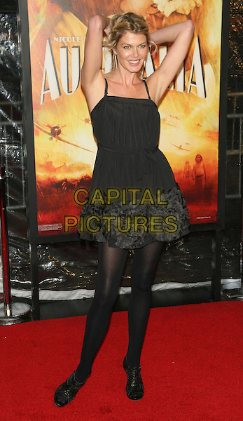 "INGRID SEYNHAEVE.New York Premiere of ""Australia"" at the Ziegfeld Theater, New York, NY, USA..November 24th, 2008.full length black grey gray dress ankle boots tights ruffled ruffles armpits arms in air .CAP/LNC/TOM.©TOM/LNC/Capital Pictures."