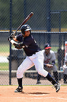 GCL Yankees 2 outfielder Wilmer Romero (87) at bat during a game against the GCL Braves on June 23, 2014 at the Yankees Minor League Complex in Tampa, Florida.  GCL Yankees 2 defeated the GCL Braves 12-4.  (Mike Janes/Four Seam Images)