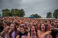 Busted fans waiting for their performing at AmpRocks 2017, part of Ampthill Festival, at Ampthill Great Park, Ampthill, England on 30 June 2017. Photo by David Horn.
