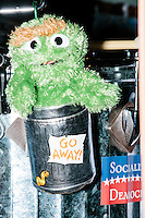 An Oscar the Grouch plush toy decorates a drum in the Leftist Marching Band performing with anti-Trump protesters gather near the Sheraton Portsmouth Harborside Hotel in Portsmouth, New Hampshire, USA. At the hotel later that evening, Republican presidential candidate and real estate mogul Donald Trump received an endorsement from the New England Police Benevolent Association executive council. Many protesters expressed disagreement with Trump's recent statements that he would ban all Muslims from entering the country. Trump brought up the recent shooting in San Berdardino, Calif., at the meeting. A small group of perhaps 20 Trump supporters stood outside the hotel. One of the protest organizers estimated that there were around 230 protesters gathered.