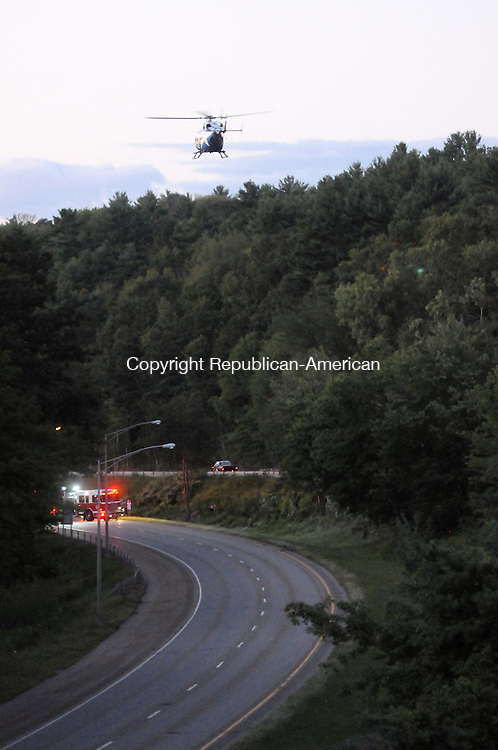 TORRINGTON, CT, 05 SEPT 13- 090513AJ01- A Lifstar helicopter takes off from Route 8 south in Torrington Thursday carrying a patient who crashed a motorcycle at about 7 p.m.  Alec Johnson/ Republican-American