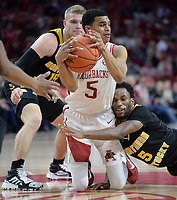 NWA Democrat-Gazette/ANDY SHUPE<br /> Arkansas guard Jalen Harris (center) fights for possession of the ball Saturday, Nov. 30, 2019, with Northern Kentucky guard Tyler Sharpe (left) and Bryson Langdon during the second half of play in Bud Walton Arena. Visit nwadg.com/photos to see more photographs from the game.