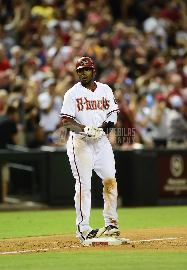 Jul. 6, 2012; Phoenix, AZ, USA: Arizona Diamondbacks outfielder Justin Upton stands on third base after hitting a two run triple in the sixth inning against the Los Angeles Dodgers at Chase Field. Mandatory Credit: Mark J. Rebilas-