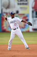 Chattanooga Lookouts third baseman Daniel Mayora (17) warmup throw to first during a game against the Birmingham Barons on April 24, 2014 at AT&T Field in Chattanooga, Tennessee.  Chattanooga defeated Birmingham 5-4.  (Mike Janes/Four Seam Images)