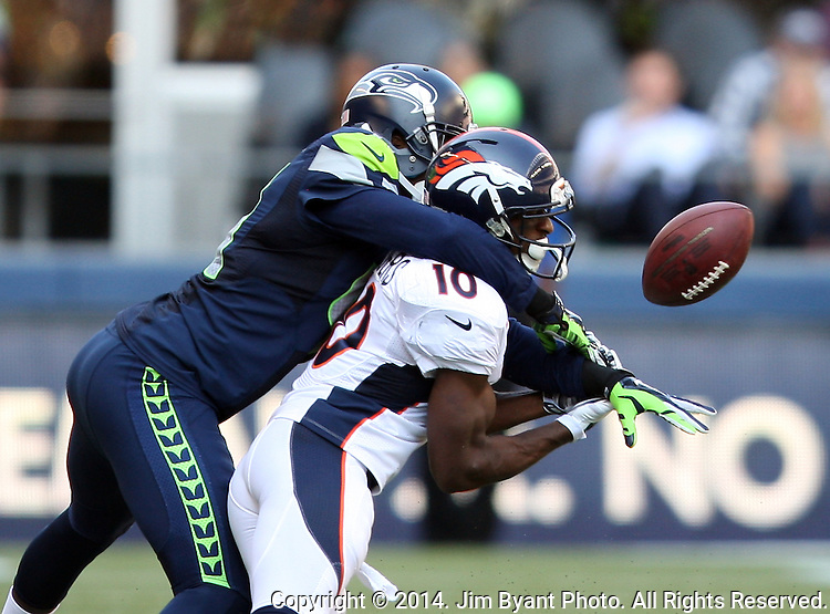 Seattle Seahawks  cornerback Byron Maxwell (41) breaks up a pass intended for Denver Broncos wide receiver Emmanuel Sanders  (10) in the third quarter at CenturyLink Field in Seattle, Washington on September 21, 2014.The Seahawks won 26-20 in overtime.    ©2014. Jim Bryant Photo. All rights Reserved.