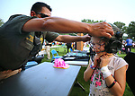 Carson City Sheriff&rsquo;s Sgt. Daniel Gonzales helps Lyric Adams, 7, try on a SET helmet during the 16th annual National Night Out event, hosted by the Carson City Sheriff's Office, in Carson City, Nev., on Tuesday, Aug. 7, 2018.<br />