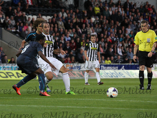 Gary Harkins lays the ball off in the St Mirren v Newcastle United friendly match played at St Mirren Park, Paisley on 30.7.13.