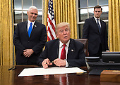 United States President Donald Trump speaks to the media before signing a confirmation for Defense Secretary James Mattis in the Oval Office at the White House in Washington, D.C. on January 20, 2017.     <br /> Credit: Kevin Dietsch / Pool via CNP