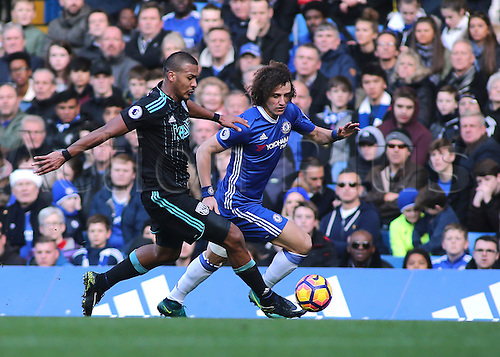 11.12.2016. Stamford Bridge, London, England. Premier League Football. Chelsea versus West Bromwich Albion. West Brom Forward Jose Salomon Rondon on his way to goal as he challenges Chelsea Defender David Luiz and forces an error to win the ball