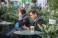A visitor to Bryant Park in New York  with his tablet computer on Tuesday, October 29, 2013.  (© Richard B. Levine)