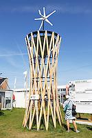 Nederland Amsterdam 2016 04 12. Fab City. Water Tower met windmolen. FabCity is een tijdelijke campus op de Kop van Java-eiland en bestaat uit zo'n vijftig innovatieve paviljoens, installaties en prototypes. Meer dan vierhonderd jonge studenten, professionals, kunstenaars en creatieven ontwikkelen de plek tot een duurzaam stedelijk gebied, waar ze werken, creëren, onderzoeken en hun oplossingen voor stedelijke vraagstukken presenteren. De deelnemers komen van verschillende onderwijsachtergronden, zoals kunstacademies, (technische) universiteiten en het beroepsonderwijs. Ingang. FabCity is een stad die werkt volgens de circulaire economie; een economisch systeem dat met maximaal hergebruik van grondstoffen waardevernietiging minimaliseert. Foto Berlinda van Dam / Hollandse Hoogte The Netherlands Amsterdam 2016 04 12. FABCITY CAMPUS FOR URBAN INNOVATORS. A temporary, freely accessible campus between 1 April until 26 June at the head of Amsterdam's Java Island in the city's Eastern Harbour District. Conceived as a green, self-sustaining city, FabCity comprise some 50 innovative pavilions, installations and prototypes. More than 400 young students, professionals, artists and creatives are developing the site into a sustainable urban area, where they work, create, explore and present their solutions to current urban issues. The participants are from various educational backgrounds, including art academies, (technology) universities and vocational colleges. Foto Berlinda van Dam / Hollandse Hoogte