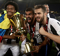 Football Soccer - Juventus - Lazio - Italian Cup Final - Olympic Stadium, Rome, Italy, May17,2017.<br /> Juventus' Juan Cuadrado (l), Tomas Rincon (c) and Miralem Pjanic (r) celebrate with the trophy after winning the Italian Cup Final match at Rome's Olympic stadium, on May 17,2017.<br /> UPDATE IMAGES PRESS/Isabella Bonotto