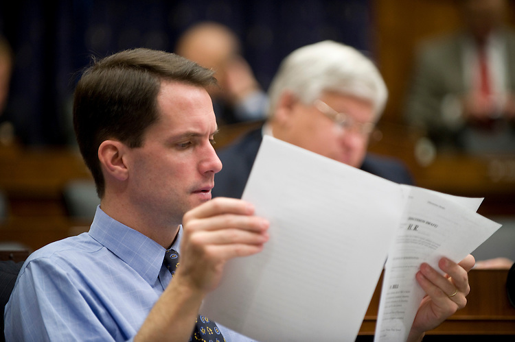 Rep. Jim Himes, D-Conn., reads a piece of draft legislation during the House Financial Services Committee markup hearing on Tuesday, oct. 27, 2009.
