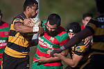 Toetu David gets well wrapped up by Tofaga Iese and Mitchell Thackam. Counties Manukau Premier Club Rugby game between Bombay and Waiuku, played at Bombay, on Saturday May 31 2014. Waiuku won the game 16 - 14 after leading 9 - 7 at halftime  Photo by Richard Spranger