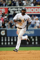 New York Yankees infielder Eduardo Nunez #26 rounds the bases after hitting a home run during a game against the Tampa Bay Rays at Yankee Stadium on September 21, 2011 in Bronx, NY.  Yankees defeated Rays 4-2.  Tomasso DeRosa/Four Seam Images