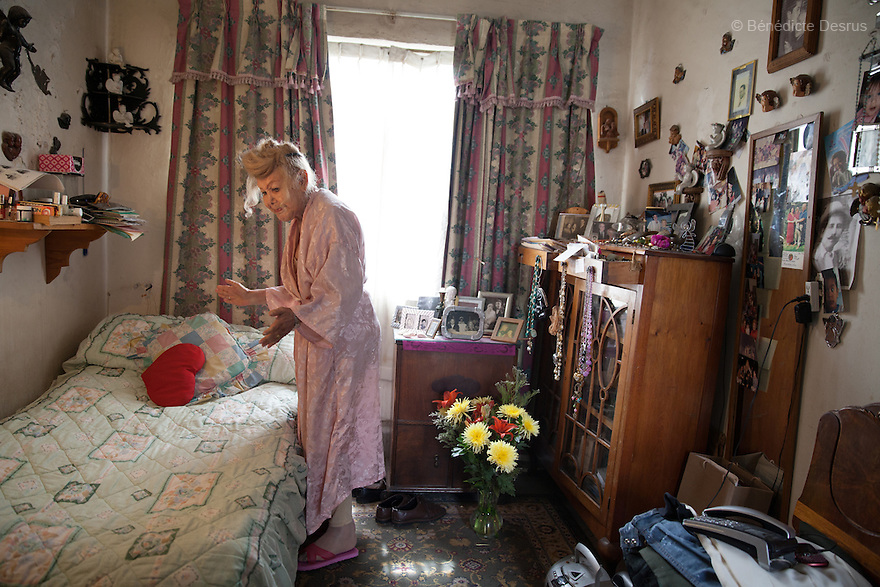 """August 26, 2013 - Mexico city, Mexico - Samantha makes her bed, before practicing her daily yoga, at her home in Mexico City. Samantha Flores is an 81-year-old transgender woman from Veracruz, Mexico. She is a prominent social activist for LGBTQI rights and is the founder of the non-profit organization """"Laetus Vitae"""", a day shelter for elderly gay people in Mexico City. Senior citizens in general are many times prone to neglect and abandonment by their families, leaving them all but invisible. Their plight can be even worse if they are homosexual. Photo credit: Bénédicte Desrus"""
