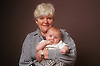 Portrait of grandmother holding young baby smiling,