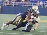 Annapolis, MD - October 21, 2017: Navy Midshipmen defensive end Nizaire Cromartie (96) tackles UCF Knights quarterback McKenzie Milton (10) during the game between UCF and Navy at  Navy-Marine Corps Memorial Stadium in Annapolis, MD.   (Photo by Elliott Brown/Media Images International)