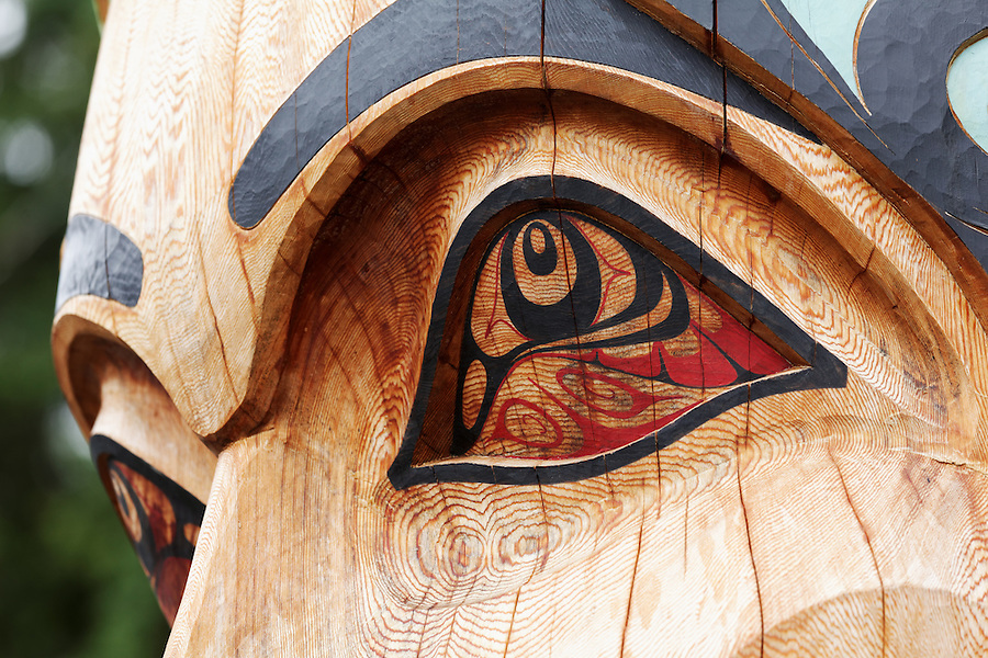 Eyes on carved face of Mother Earth on Wooch Jin Dul Shat Kooteeya totem pole, Sitka National Historical Park, Sitka, Alaska, USA