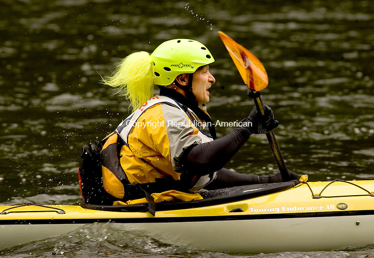 WEST CORNWALL, CT--19 MAY 2007--051907JS25- A Kayaker make his way down the Housatonic River near the covered bridge in West Cornwall on Saturday during the 37th annual Housatonic Downriver Race. Canoes and kayaks started the 10-mile course at the CL&amp;P hydroelectric plant in Falls Village and ended at Housatonic Meadows picnic area in Cornwall. <br /> Jim Shannon / Republican-American