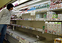 March 23, 2011, To,orozawa, Japan - Milk and dairy products are removed from the racks at a local supermarket in Tokorozawa, a western suburb of Tokyo, on Wednesday, March 23, 2011.Japanese Prime Minister Naoto Kan told two prefectures near a troubled nuclear power plant Wednesday not to sell vegetables and raw milk, which may carry health risks in the long run because of increasing levels of radiation. (Photo by Natsuki Sakai/AFLO) [3615] -mis-..