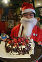 December 24, 2016, Tokyo, Japan - A man in Santa costume displays a Christmas cake decorated with insects such as cicades and mealworms at a Christmas party to eat insect foods in Tokyo on Saturday, December 24, 2016. Some 30 people gathered to eat insect foods on the Christmas Eve as UN FAO reported that eating insects could help boost nutrition and reduce pollution.  (Photo by Yoshio Tsunoda/AFLO) LWX -ytd-