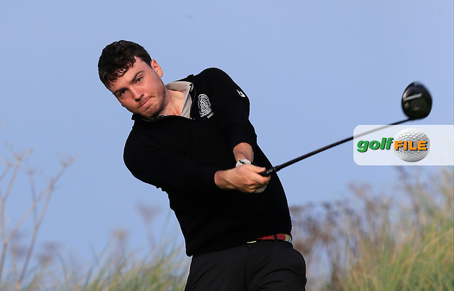 Conor Ringland (TCD) on the 17th green during Round 1 of the Irish Intervarsity Championship at Rosslare Golf Club on Wednesday 4th November 2015.<br /> Picture:  Thos Caffrey / www.golffile.ie