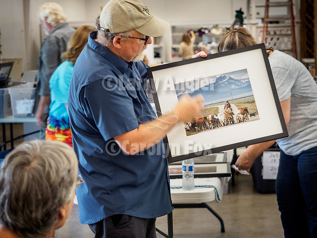 Judging of the Professional Photography entries at the 79th Amador County Fair, Plymouth, Calif.<br /> <br /> Judge Randy Allen.<br /> <br /> Best Fair Theme, Professional, Larry Angier<br /> <br /> Andy Baldauf drives the longhorn in Montana's Big Hole Valley<br /> <br /> A hat's off to Leslie and David Schupp and their great crew of volunteers who take it all in, set-up for the judging then in a short time, hang nearly 400 entries for everyone to enjoy!<br /> <br /> #DavidSchupp, #LeslieSchupp, #AmadorCountyFair, #TourAmador, #VisitAmador, #Photography, #AmadorCountysPhotographers