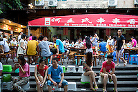 People wait for tables at He Wang Shi Chuan Chuan Xiang Huo Guo, a skewer-style hotpot restaurant popular with locals on Tiyu Road in Chongqing, China. <br /> <br /> Individual servings of meat, vegetables, and tofu, are placed on skewers which diners choose to add to their table's hotpot. The restaurant, which has many favorable online reviews, often has a long wait for tables.