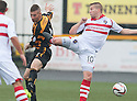 Stirling's Steven Doris goes in high on Alloa's Darryl Meggatt.