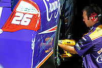 Apr 17, 2009; Avondale, AZ, USA; A crew member for NASCAR Sprint Cup Series driver Jamie McMurray (not pictured) works on his car after hitting the wall during practice for the Subway Fresh Fit 500 at Phoenix International Raceway. Mandatory Credit: Mark J. Rebilas-