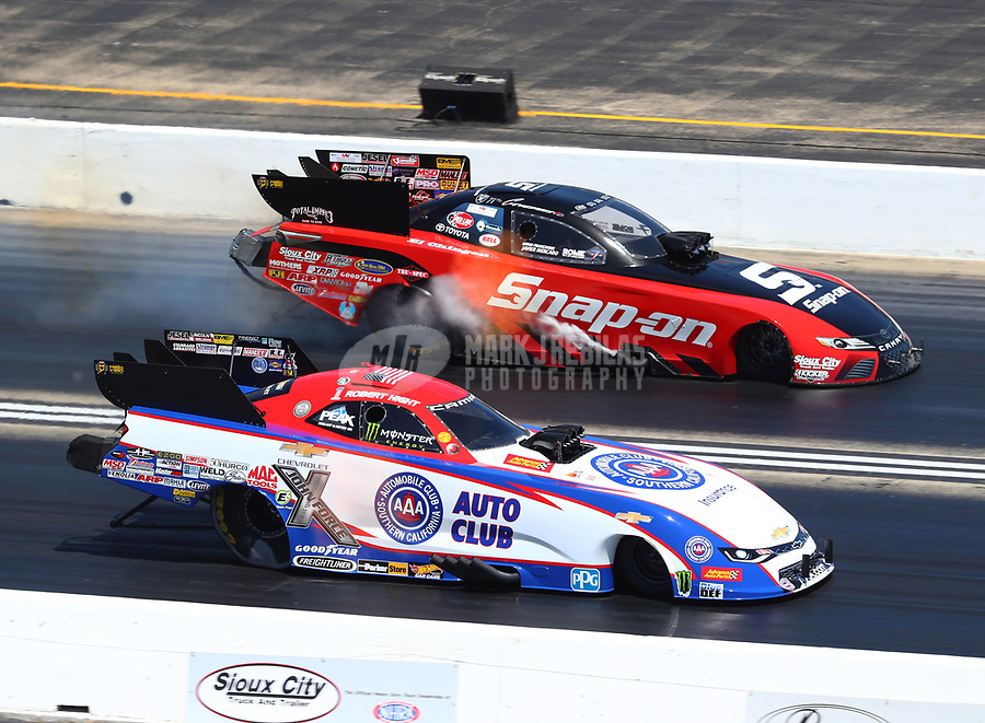 Jun 3, 2018; Joliet, IL, USA; NHRA funny car driver Robert Hight (near) alongside Cruz Pedregon during the Route 66 Nationals at Route 66 Raceway. Mandatory Credit: Mark J. Rebilas-USA TODAY Sports