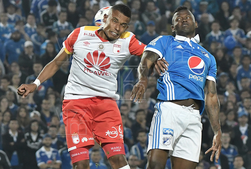 BOGOTA - COLOMBIA -16 -07-2017: Duver Riascos (Der) jugador de Millonarios disputa el balón con William Tesillo (Izq) jugador de Independiente Santa Fe durante partido partido por la fecha 2 de la Liga Aguila II 2017jugado en el estadio Nemesio Camacho El Campin de la ciudad de Bogota. / Duver Riascos (R) player of Millonarios fights for the ball with William Tesillo (L) player of Independiente Santa Fe during match for the date 2 of the Liga Aguila II 2017played at the Nemesio Camacho El Campin Stadium in Bogota city. Photo: VizzorImage / Gabriel Aponte / Staff.