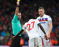 Referee Paul Tierney  gives a yellow card to Badou Ndiaye of Stoke City watched by Ryan Shawcross of Stoke Cityduring AFC Bournemouth vs Stoke City, Premier League Football at the Vitality Stadium on 3rd February 2018
