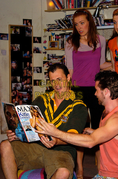 "BLAIR McDONOUGH & JONATHAN DUTTON.""The Vegemite Tales"" Production Photocall, The Venue Theatre, London, England, July 31st 2007..half length sitting play scout's uniform top Jonathon reading Maxim magazine.CAP/CAN.©Can Nguyen/Capital Pictures"