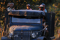 Agricultural workers on the back of a truck on the road between Taungoo and Nay Pyi Daw.