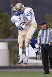 Reed's Porter Hansen and Nate Foreman celebrate after Hansen runs the opening kick off back for a touchdown against Carson during the NIAA D-1 North title game at Bishop Manogue High School in Reno, Nev., on Saturday, Nov. 29, 2014.<br /> Photo by Cathleen Allison