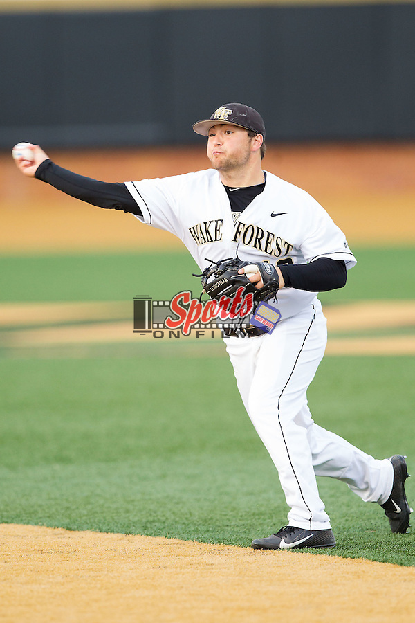 Wake Forest Demon Deacons second baseman Nate Mondou (10) makes a throw to first base against the Maryland Terrapins at Wake Forest Baseball Park on April 4, 2014 in Winston-Salem, North Carolina.  The Demon Deacons defeated the Terrapins 6-4.  (Brian Westerholt/Sports On Film)
