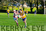 Beaufort's  Brendan Cronin gets away from St. Pats Brendan Poff at the county league Div 3 St Pats Blennerville v Beaufort at Blennerville on Saturday